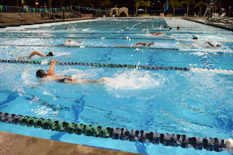 Sage Creek Swim team members warm up during practice. Swim team practices every Monday through Friday at Alga Norte Aquatics Center.