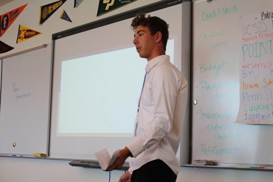 Junior Garrett Taylor pitches his Genius Project, in which revolves around developing video games that help students do better on history tests.