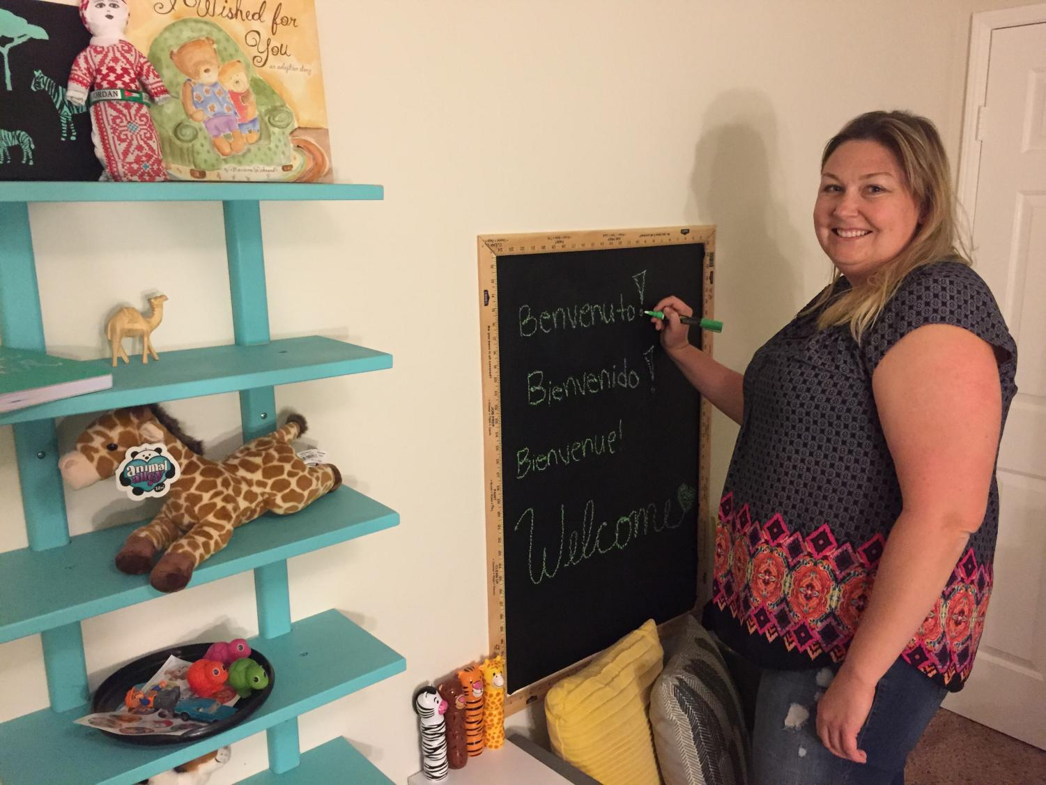 Allison and Samantha Williams prepare the new baby room as they anticipate the AP Psychology teacher's confirmation for adoption.