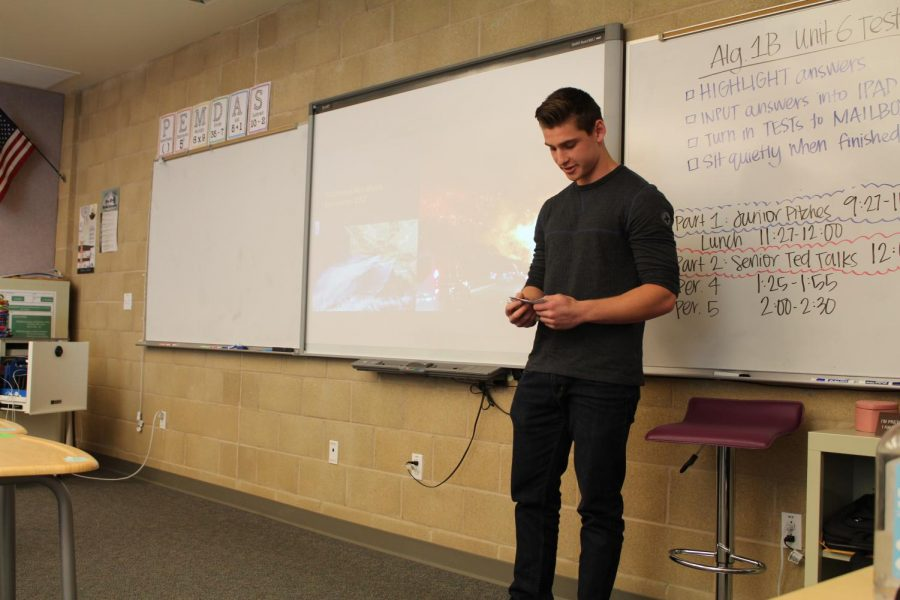 Junior Steele Dargie presents his Genius Project to the audience of seniors and teachers. On April 26, juniors and seniors presented their projects to each other, providing constructive criticism and advice on each other's progress and project outcome.