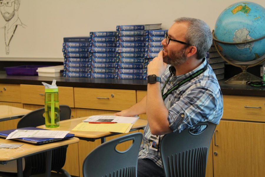 History teacher Leif Peterson listens to a student pitch their Genius Project to the class. On April 26, juniors and seniors alike presented their progress and shared advice on their projects to freshmen, sophomores, and each other.