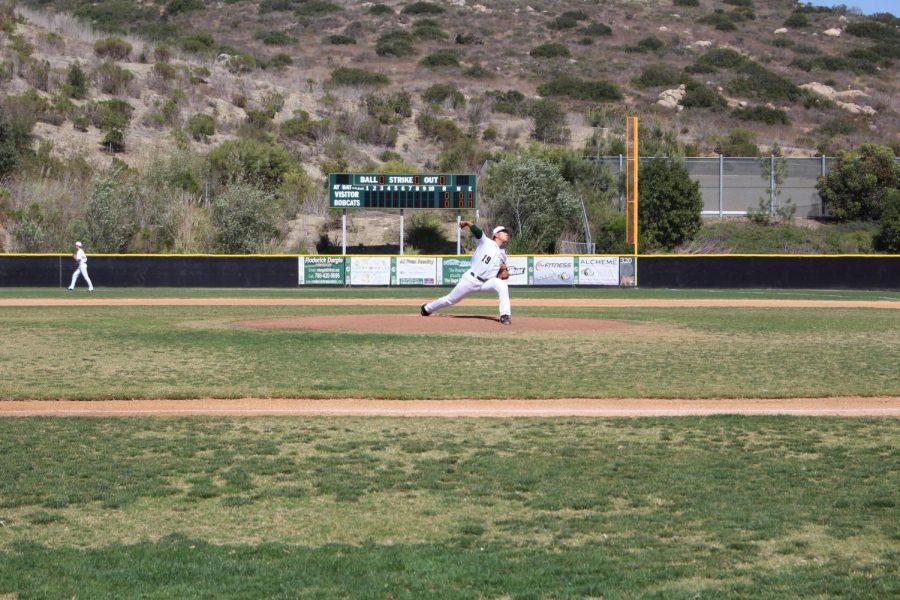 Junior Ethan Sakata throws a vicious pitch in the Sage Creek vs. Carlsbad High School baseball game.
