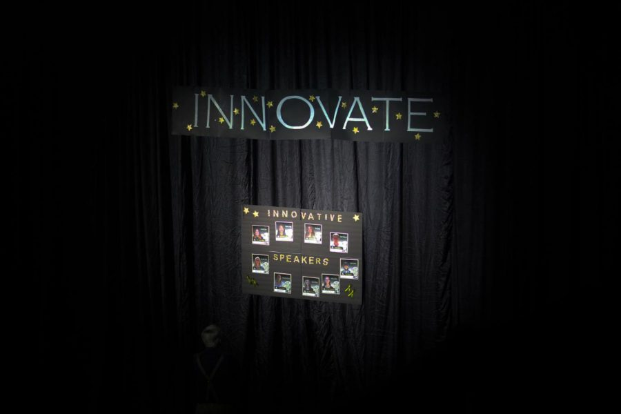 Innovate: the thematic concept that was present throughout the entirety of the 2017-2018 Genius Project Symposium. This sign had been cascaded amongst the far left wall of the Gym and had depicted all of the 17 various speakers that would be represented both on screen and on stage.