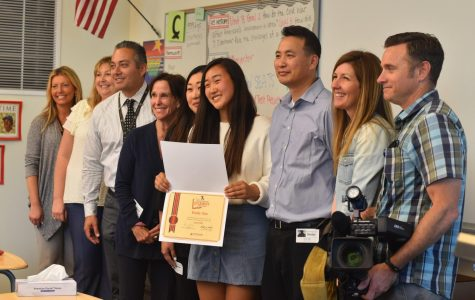 """Senior Emily Sim, stands proudly with her newly accumulated certificate, next to her parents and school staff. She was interviewed on her successes with her """"Senior Prom"""" Genius project for NBC 7 News broadcasters."""