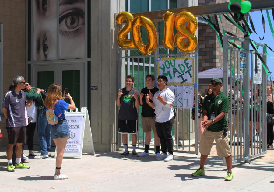Campus supervisor, Dan DeLeon stands by Sage Creek's front entrance in order to say some of his final goodbyes to the class of 2018.