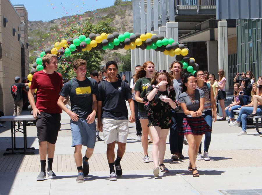 Members of Mrs. Alberts advisory class take the lead as the first group of students to walk down the academic mall during the senior walk off of 2018.