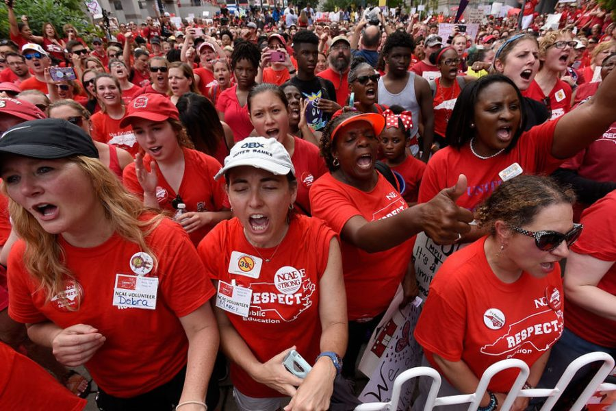 Teachers+in+North+Carolina+marched+at+their+capital+Raleigh+on+Wednesday%2C+May+16th+wearing+matching+red+shirts+and+carrying+posters.+North+Carolina+teachers+joined+many+other+states+in+marching+for+fair+wages%2C+benefits%2C+and+better+education+funding.