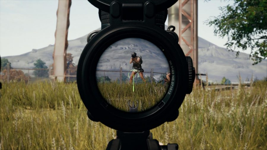 A player looks through the scope of a rifle, preparing to line up her shot. Among the various weapon attachments that can be found in Playerunknown's Battlegrounds are magnified optics of different magnifications.