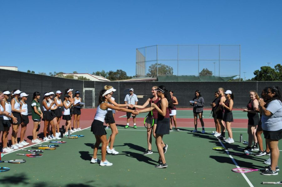 Sage Creek's girls tennis team conclude their game against Rancho Buena Vista with handshakes and smiles. The tennis team took home a win with a score of 16-2 against the longhorns and will be competing against San Dieguito Academy at 3pm this Thursday, Sept. 27.