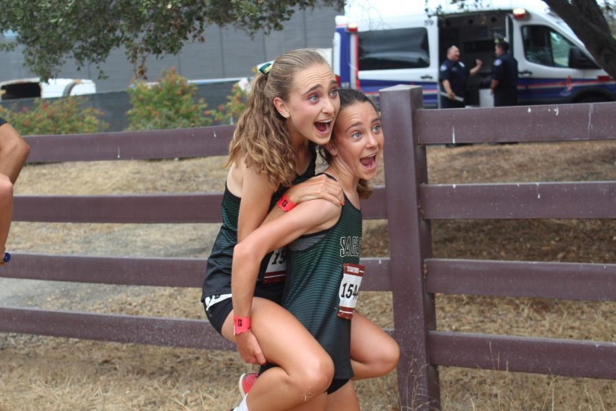 Sisters Skyler and Stormy Wallace celebrating their cross country race at Stanford University together with a piggy back picture! Junior Skyler Wallace finished 5th overall and freshman Stormy Wallace came in right after her getting 7th overall!