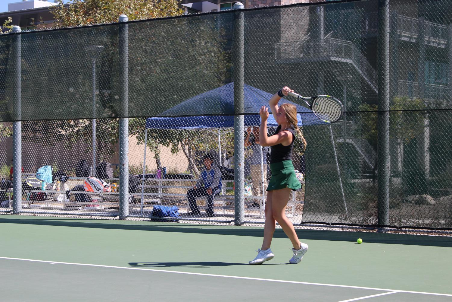 Senior+Lindsey+Williams+swung+her+racket+in+warm-ups+when+getting+ready+for+the+game+against+Fallbrook+last+Tuesday.+The+lady+Bobcats+took+the+win+with+a+score+of+15-3.