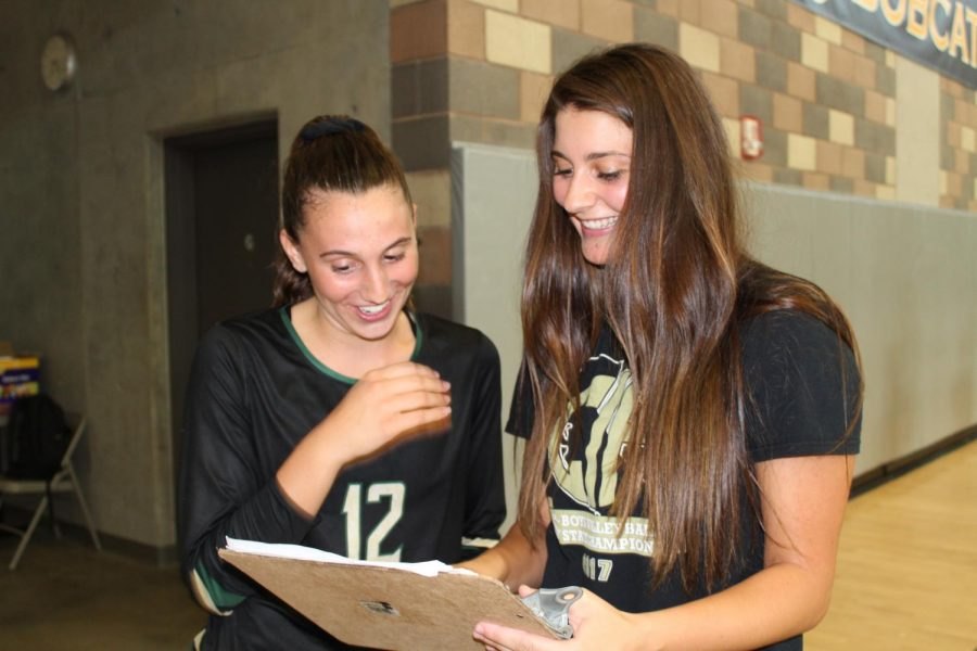Junior Varsity coach Ana Huberty discussing game plans with freshman player Brooke DeGraan in the Bobcat Arena. The JV team competed against Mission Hills High School on Sept. 11.