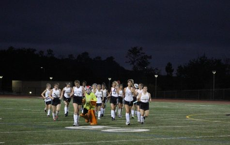 Sage Creek Field Hockey team sprints in after celebrating with the goalie. They completed a 4-0 sweep over El Cajon Valley.