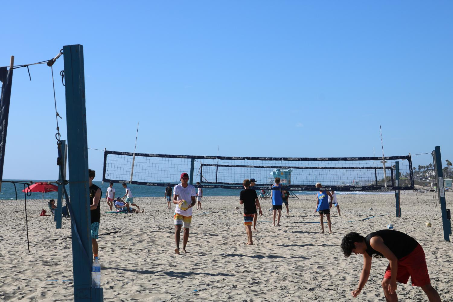 Bobcats and Knights fill up the Tamarack Beach courts in the fifth match of the season.