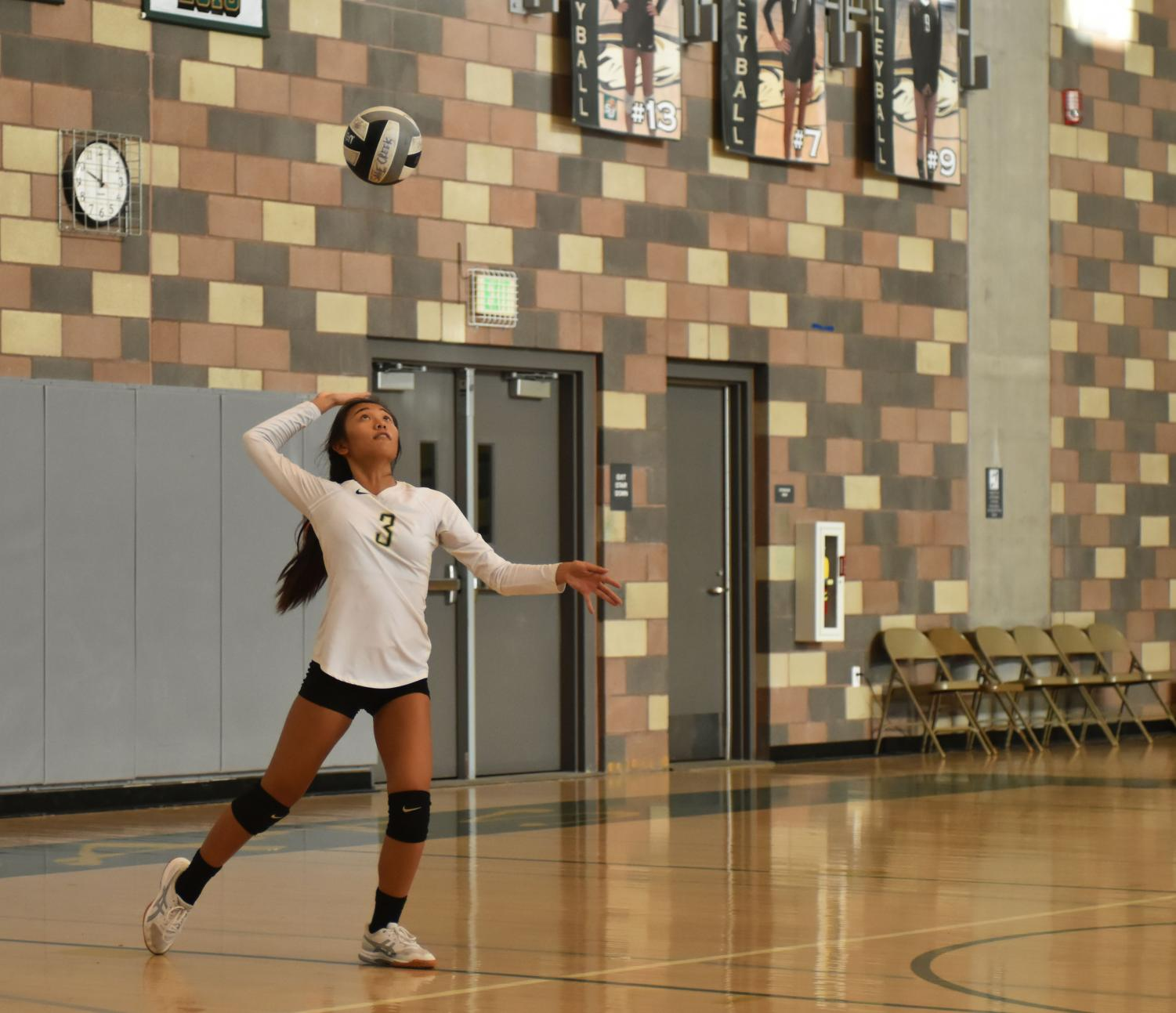 Freshman%2C+Bethany+Elizabeth+Tomaneng+uses+an+overhead+serve+during+the+girls+varsity+volleyball+match+against+Helix+Charter+High+School.+The+Sage+Creek+girls+varsity+volleyball+team+took+the+win+against+Helix+on%2C+Sept.+5+with+a+score+of+3-0.