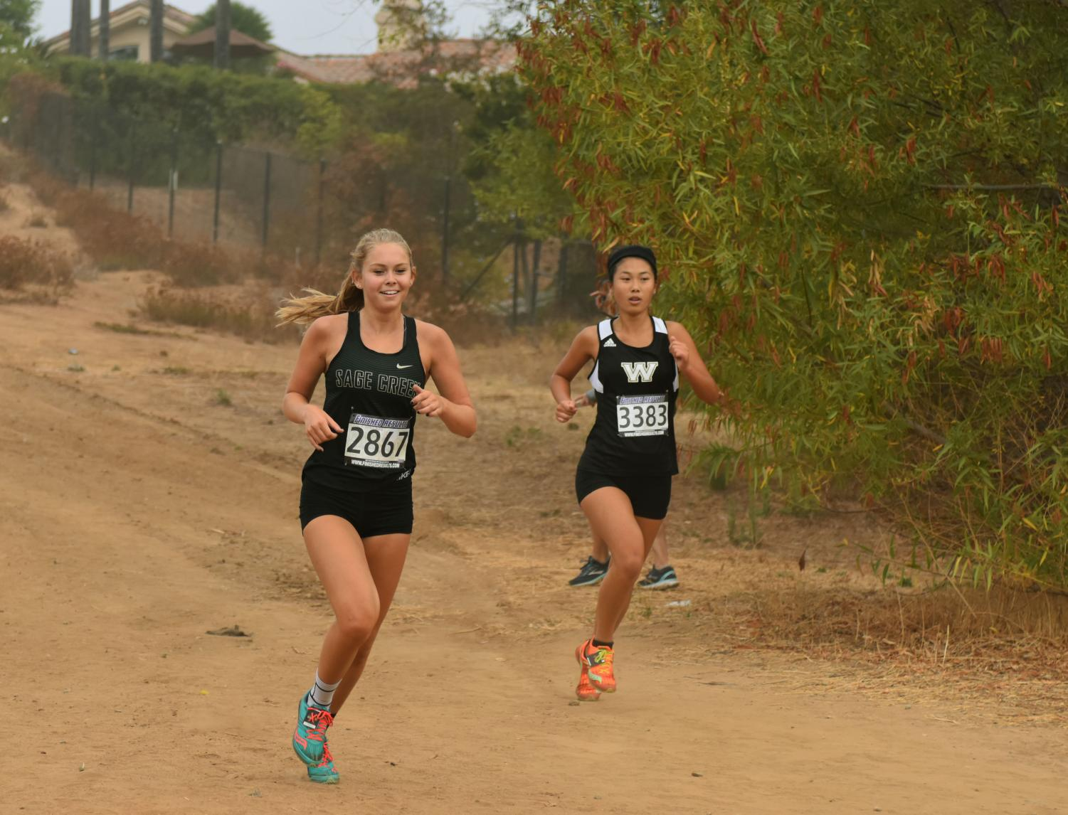 Junior%2C+Addie+Ebbs%2C+competes+in+the+girls+varsity+division+1+cross+country+race+this+past+Saturday+at+the+Bronco+Round-Up+meet.+This+being+the+very+first+cross+country+meet+of+the+season+at+Kit+Carson+Park%2C+the+girls+varsity+team+took+1st+place.