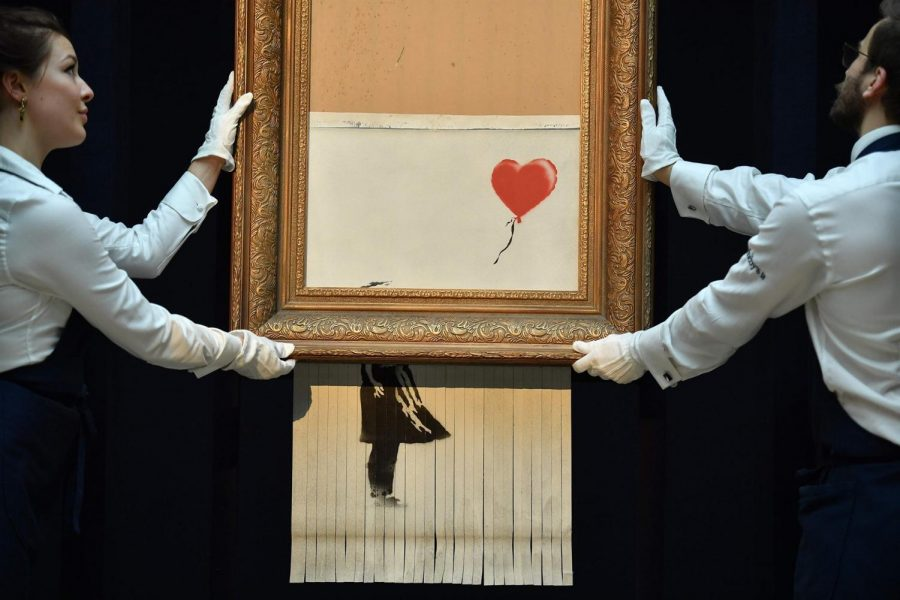 Banksy shredded his artwork, making the piece worth more than it was ever originally.The girl's face cannot be seen but the red balloon still taunts her.