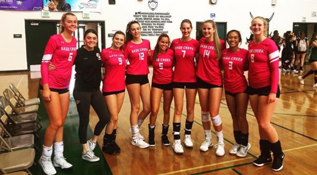 Girls+volleyball+rolling+with+the+pink+uniforms.+They+wore+these+jerseys+throughout+the+month+of+October.+%0A