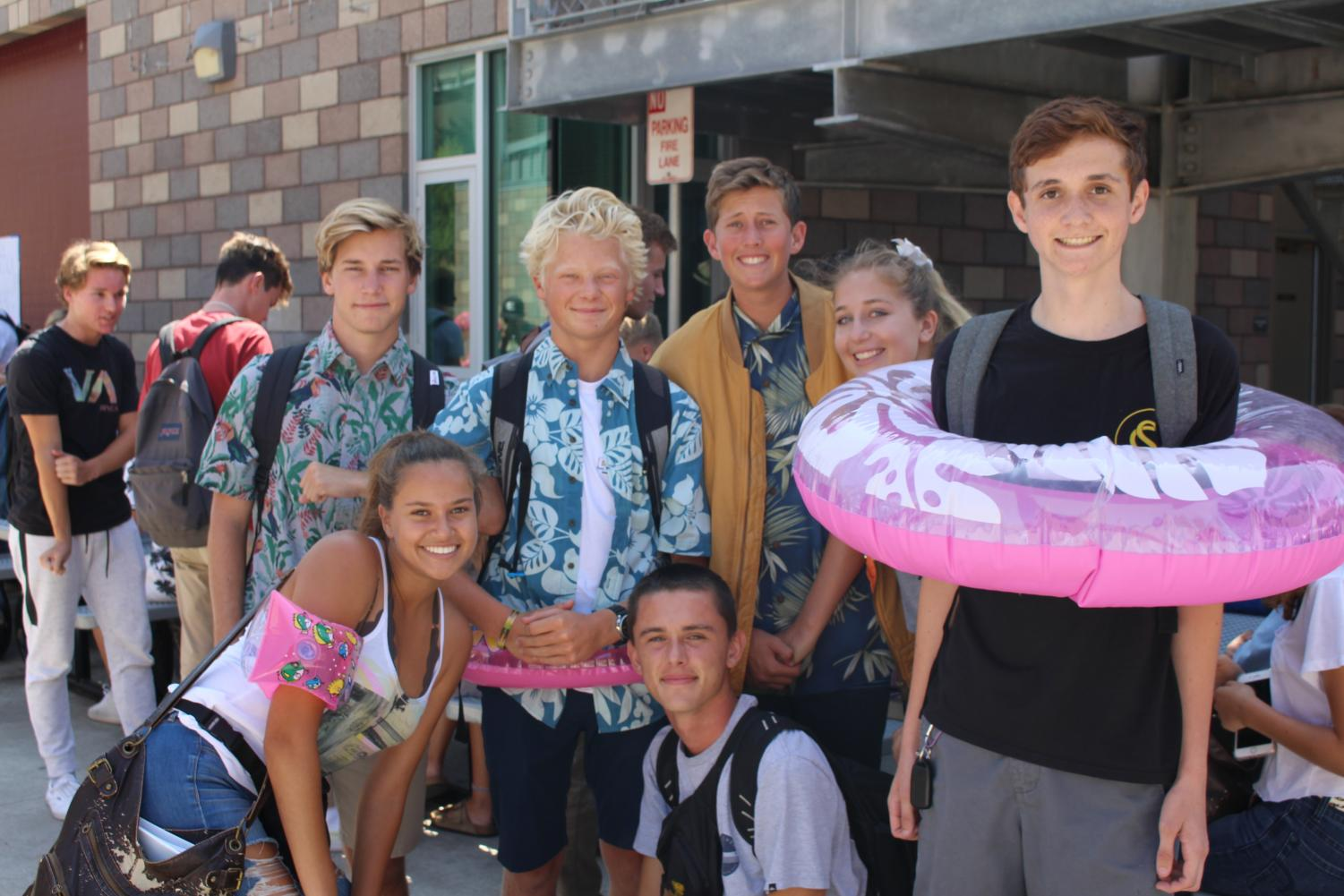 """Seniors Carla Kelliny, Adam Salter, Oliver Schnitzenbaumer, Chris Engel, Jackson Ginn, Maddie Devilbiss and Tim Baxter, show Bobcat spirit for """"Floaty Friday"""". Seniors anticipate the start of senior assassins by participating in the spirit day that helped them get in the habit of wearing a floaty for protection against their """"assassins."""""""