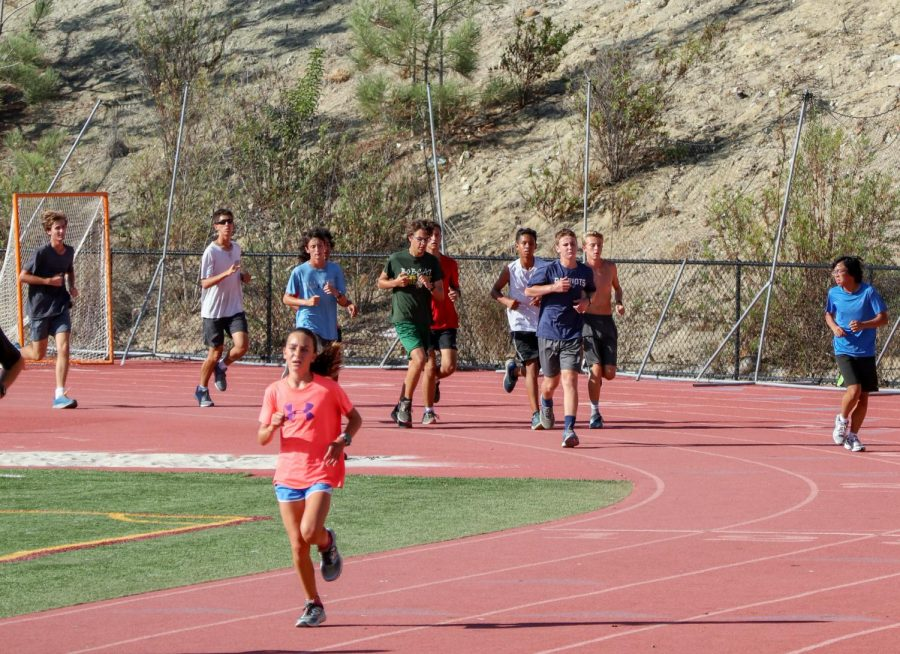 """Sage Creek's cross country team practices on the track after school on Monday, Oct. 8. During practice, athletes completed a """"tempo run"""" to simulate race pace conditions."""