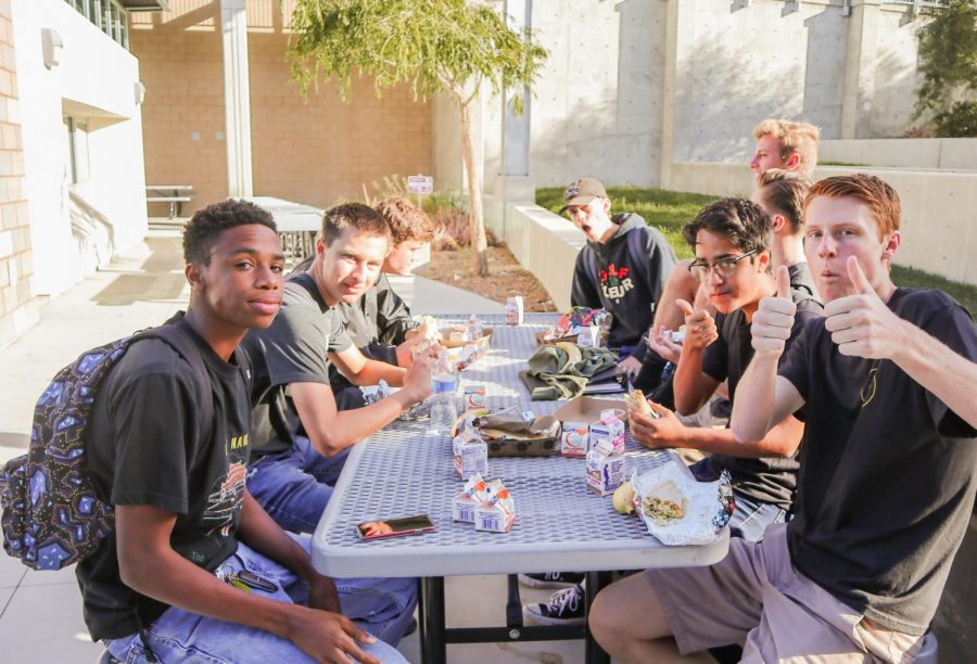 A group of seniors enjoy breakfast burritos served to them after the annual senior panoramic photo. Seniors were also provided with complementary sides of fresh fruit and juice.