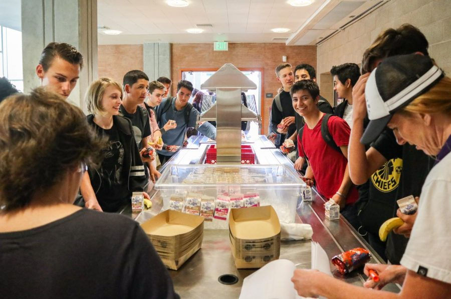 Seniors eagerly await steaming breakfast burritos inside the cafeteria. In keeping with tradition, a warm breakfast was served after the annual senior panoramic photo this past Wednesday, Oct. 10.
