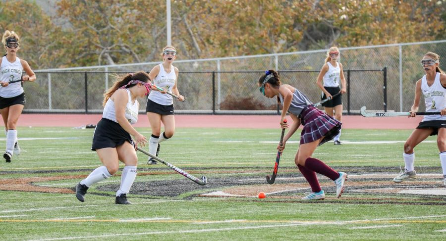 Junior Lyla Killon aggressively plays against an opponent  from Ranch Buena Vista in a tough game of Feild Hockey. During the game, both teams gave all they had, with Rancho Buna Vista taking the win in the end.