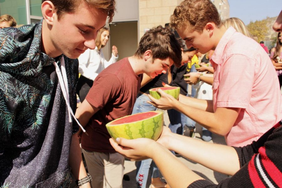Contestants are ready to face off in the watermelon eating contest at lunch on Thursday, Oct. 25. Participants raced to finish the watermelon with their hands behind their back.