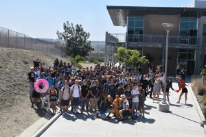 Seniors gather between the 2000 and 3000 buildings to prepare for Senior Assassins. The game is organized by students, for students.