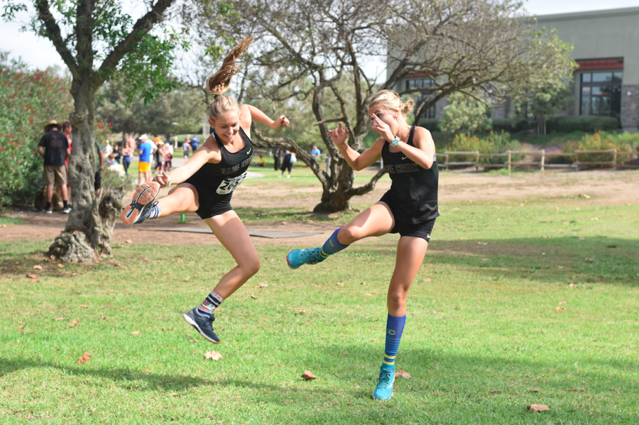 Juniors Addie Ebbs and Natalie Huestis jumping for joy for the varsity cross country girls win at the Central Park Invitational this past Saturday, Oct. 6. The team continues to be in high spirits with their continual success throughout this season.