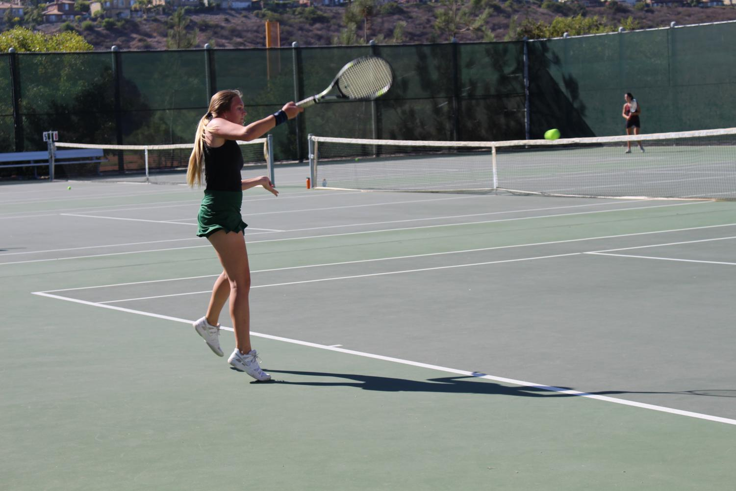 Senior Lindsey Williams takes a quick swing with her racket during the match against RBV.