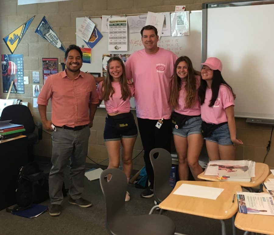 Social science teachers Tamayo and Bloomquist take a picture with Hauser and her friends on Breast Cancer Awareness Day. Hauser formed a long-lasting friendship with her teachers throughout high school.
