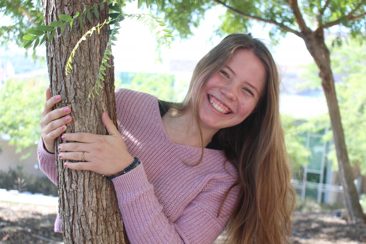 With even more happiness than before, Kailiyah Hauser demonstrates her love for nature and everything kind by posing near the Sage Creek trees while talking about her life.