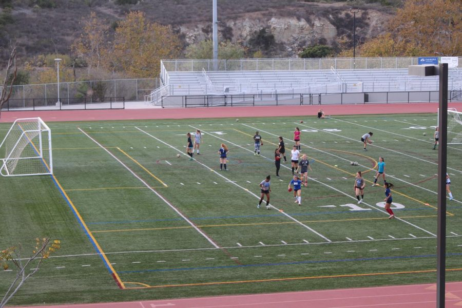 The jv girls soccer team practices to prepare for their upcoming season. There were a large number of girls that showed up for tryouts and many of them have been incorporated into the team.