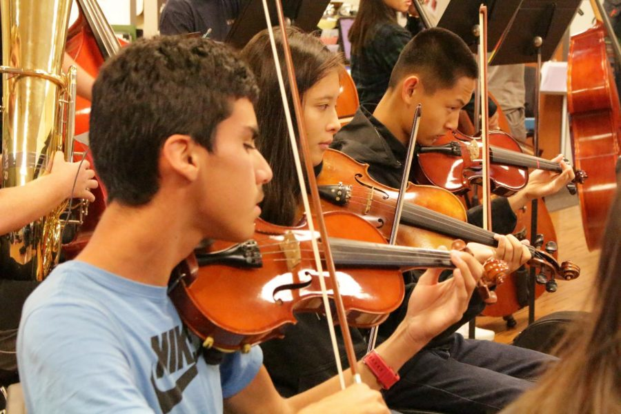 """Students in orchestra have no ordinary lesson plan in their classroom. Orchestra teaches  """"learn by doing,"""" therefore, students practice with their instruments until a song is perfected."""