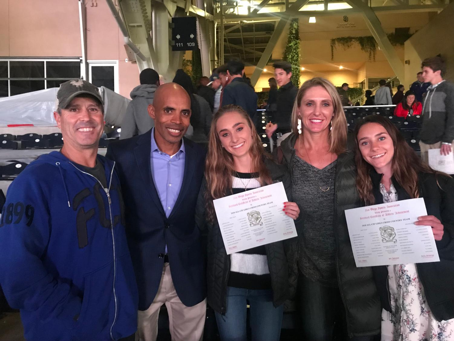 Junior+Skyler+Wallace+and+freshman+Stormy+Wallace+meet+Olympic+runner+Meb+Keflezighi.+The+girls+attended+Petco+Park+last+Wednesday+to+receive+the+award+of+All+CIF+for+the+2018+Cross+Country+season.