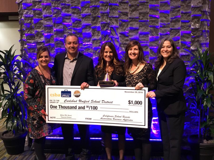 Holding a 1,000 dollar prize from CSBA is CSBA Vice President-Elect Tamara Otero, César Morales, Shannon Alberts, Corrie Myers and CSBA Vice President Xilonin Cruz-Gonzalez. The usage of the prize money will be talked about with the Genius Project committee and decided on as a group.