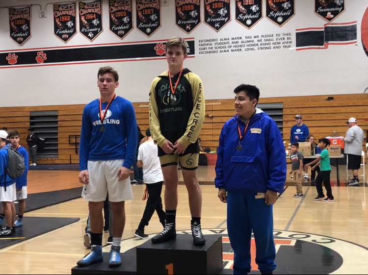 Freshman+Luke+McLellan+stands+on+the+first+place+podium+last+Friday.+The+freshman+wrestling+team+had+a+tournament+at+Escondido+High+School+were+McLellan+took+first+in+the+172+weight+class.