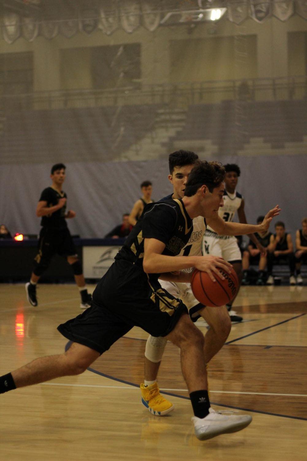 Senior+Matthew+Korf+dribbles+the+ball+down+the+court+where+the+San+Marcos+defense+is+waiting.+Korf+passed+the+ball+to+his+teammates+to+give+them+a+chance+to+score.+