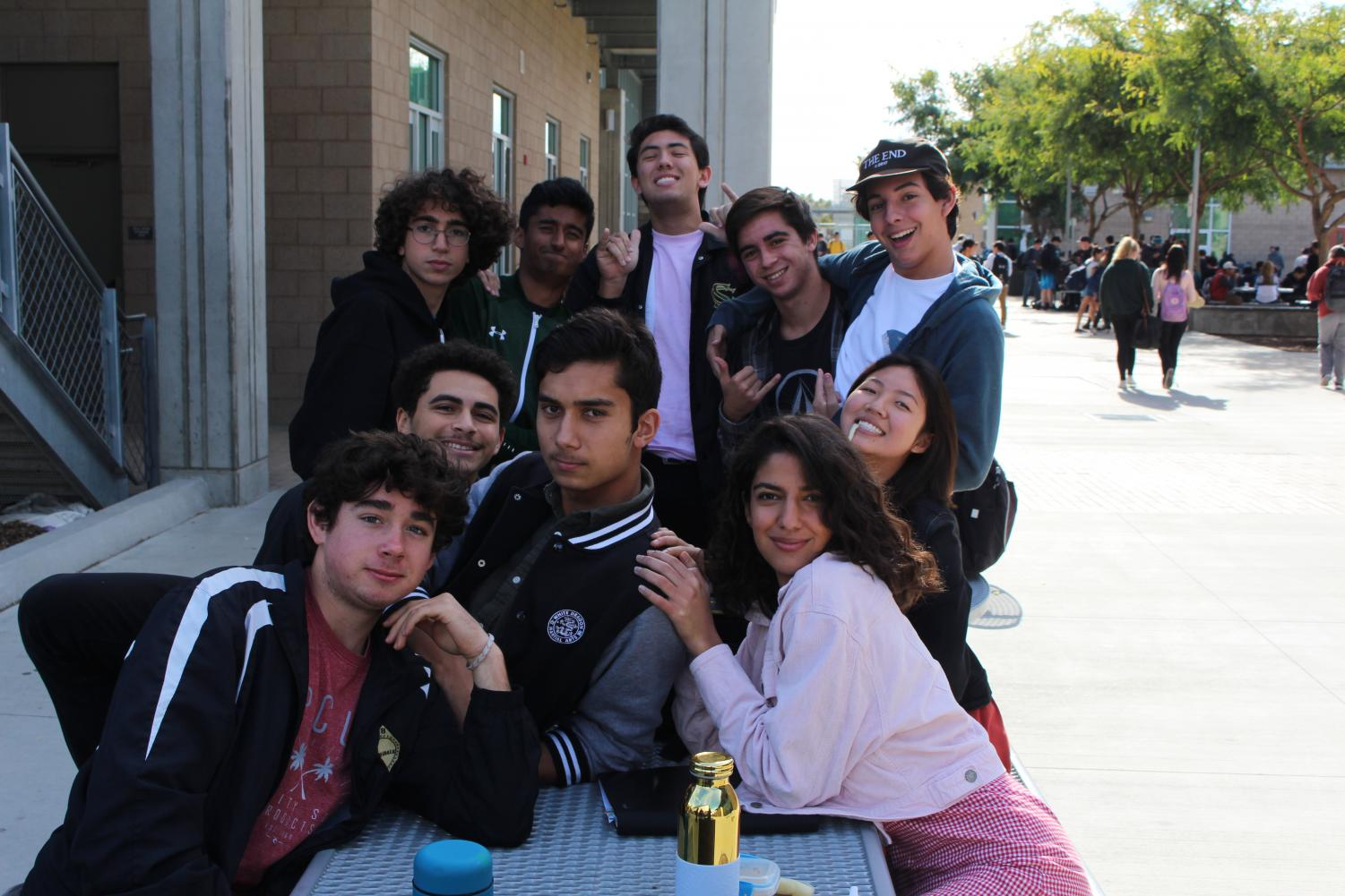 A+group+of+seniors+with+an+addition+of+freshman+Shervin+Bahmanpour%2C+took+a+few+moments+to+pose+at+lunch+this+Tuesday.