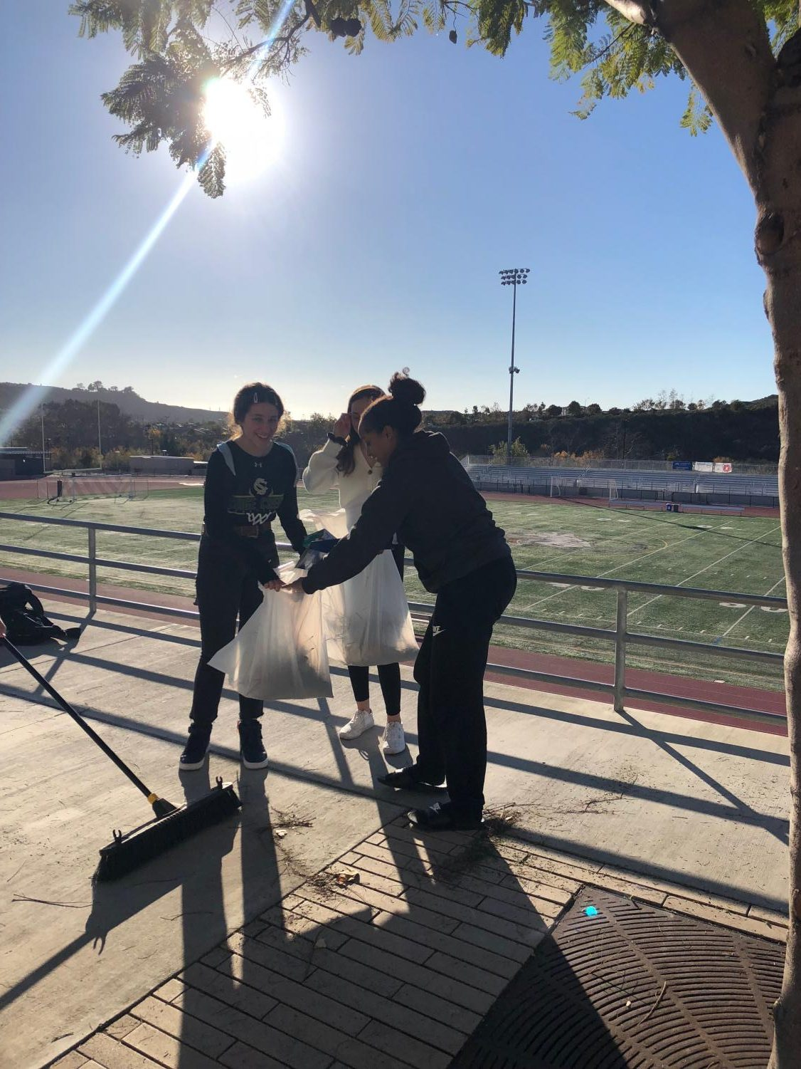 Students+clean+up+debris+from+trees+on+the+Athletic+Mall+during+the+Student-Athlete+Advisory+Committee%E2%80%99s+campus+cleanup.+The+student-athletes+not+only+focused+on+picking+up+trash+but+also+swept+dirt+and+debris+that+they+found+along+the+academic+mall.+