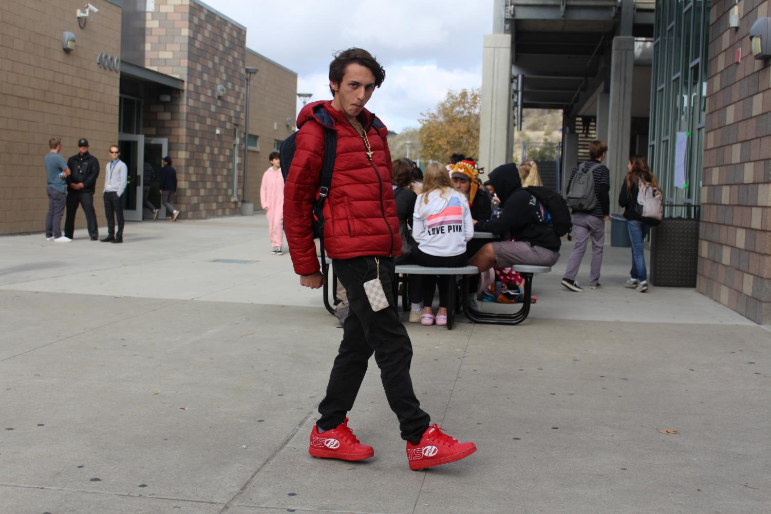 Senior+Preston+Acevedo+strikes+a+pose+as+he+glides+through+the+academic+mall+on+his+candy+cane+red+Heelys.+Thursday%E2%80%99s+spirit+day+was+Candy+Cane+day+where+students+showed+their+school+spirit+by+dawning+as+much+red+as+they+could.+