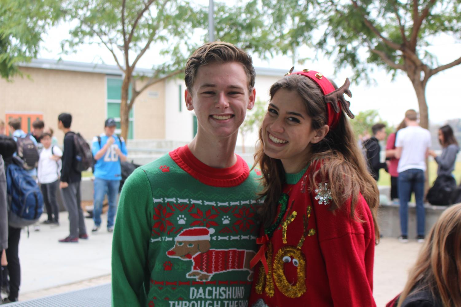 Juniors+Maddie+Connelly+and+Charlie+Roth+enjoy+their+last+day+together+until+winter+break.+To+wrap+up+the+spirit+week%2C+students+wore+ugly+Christmas+sweaters.+