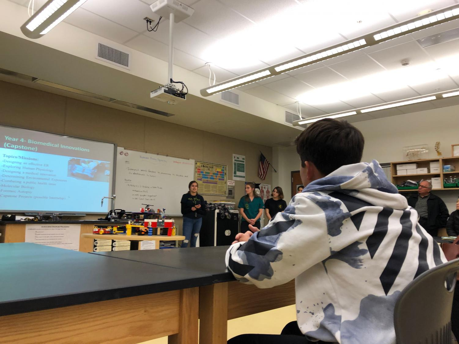 Fourth+year+Biomed+students+describe+their+experience+and+the+attraction+of+the+class+to+prospective+students+and+parents+during+the+breakout+session+part+of+the+Eighth+Grade+Showcase+Tuesday+night.+The+night+was+supplemented+with+many+senior+and+junior+volunteers+who+provided+their+student+views+on+all+the+opportunities+at+Sage+Creek.+
