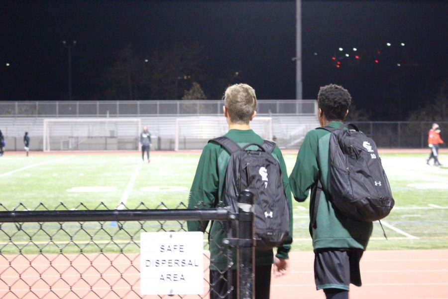 Titus Washington and Jet Trask walk onto the field ready to secure the win against the opposing team. Their next game is Tuesday, Jan. 15 at Oceanside high school.