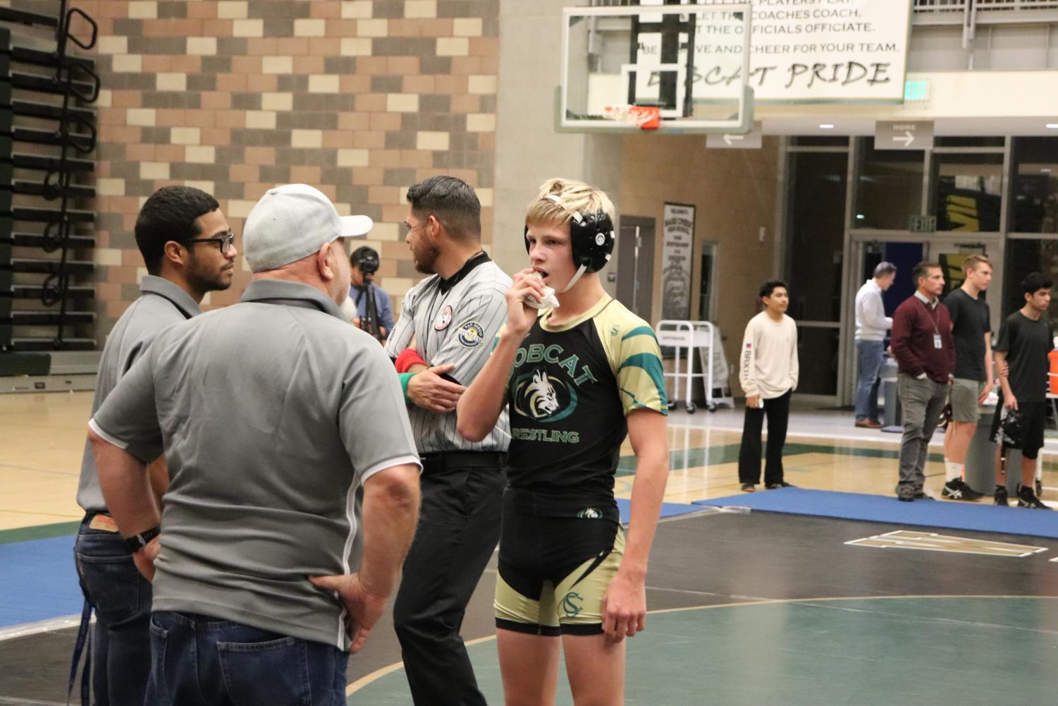 Freshman+Peter+Rubin+holds+a+paper+towel+on+his+mouth+to+stop+his+lip+from+bleeding.+At+wrestlings+home+duel+on+Thursday%2C+Jan.+10++against+Rancho+Buena+Vista%2C+Rubin%E2%80%99s+match+was+stopped+numerous+times+due+to+his+mouth+bleeding.+