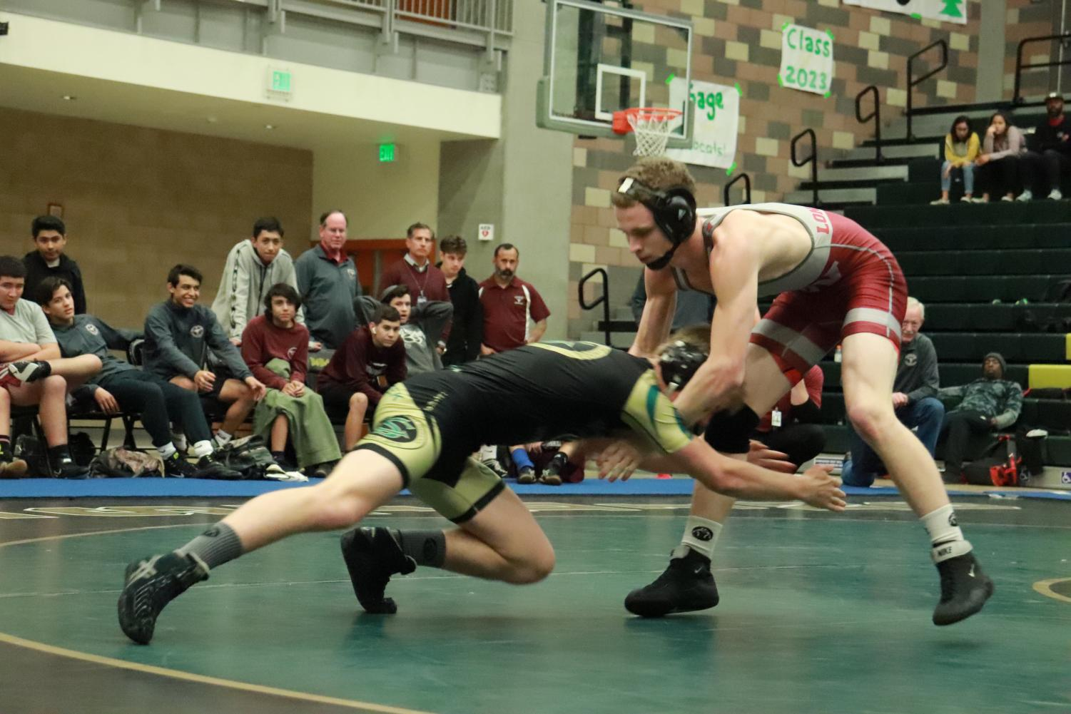 Junior+Cole+Kirby+shoots+in+for+a+double-leg+on+his+Rancho+Buena+Vista+opponent.+Kirby+wrestled+up+a+weight+class+this+duel+at+132.