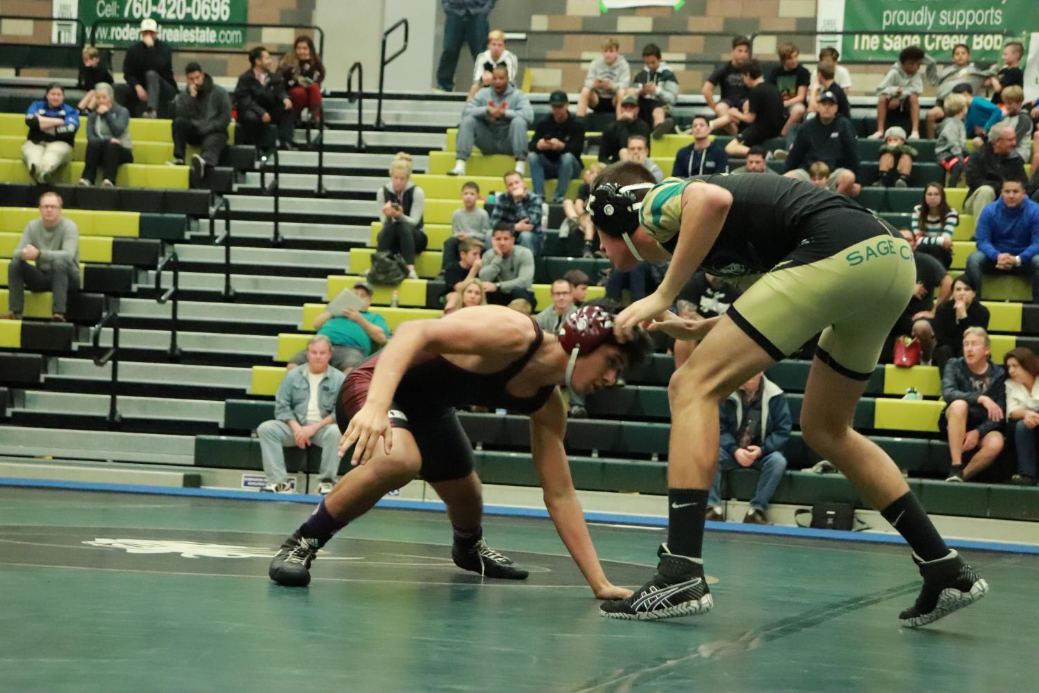 Junior+Miguel+Rojas+prepares+for+his+next+move.+Miguel+wrestled+in+the+138+weight+class+for+the+Thursday+duel.