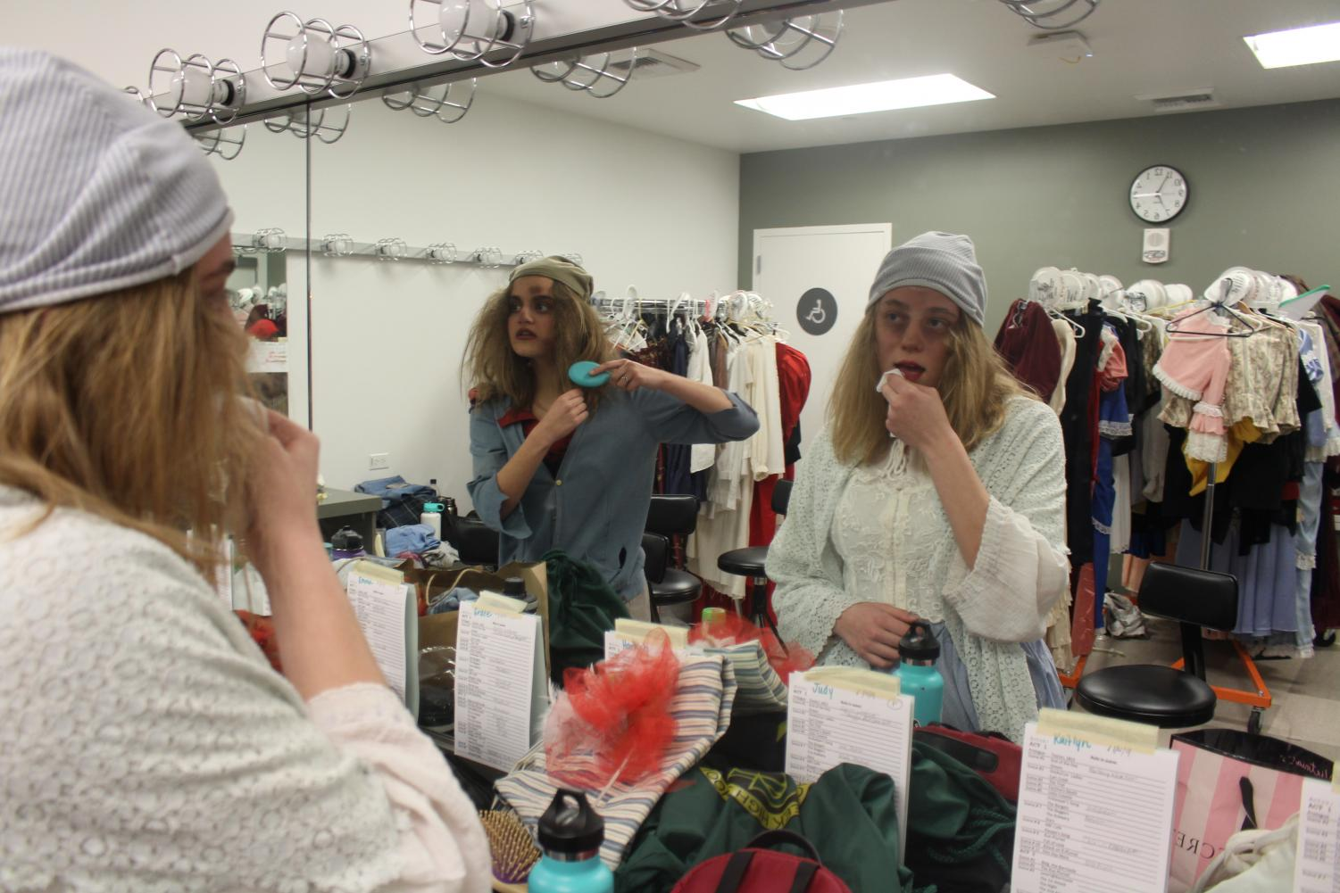 Hannah+Katz+and+Emma+Belnap+do+their+hair+and+makeup+before+the+show+begins.+Both+Katz+and+Belnap+are+involved+in+advanced+theater+at+Sage+Creek+regardless+of+the+fact+they+are+only+sophomores.+