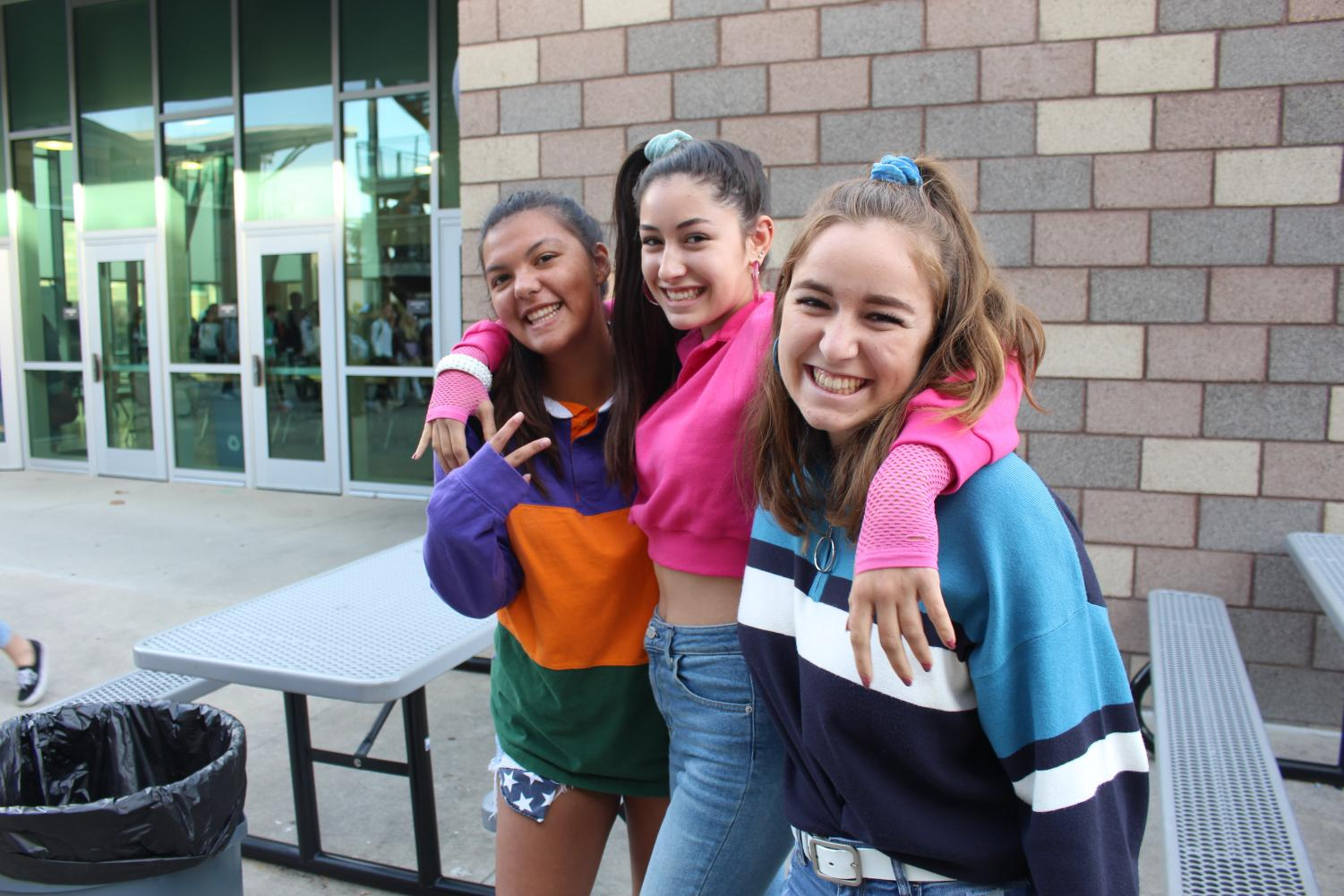 Students+travel+back+to+the+1980s%21+Last+Tuesday+students+including+seniors+Tori+Cudal%2C+Olivia+Mejia+and+Allison+DelGrande+dress+up+from+head+to+toe+for+the+school%27s+%22Decade+Spirit+Day.%22